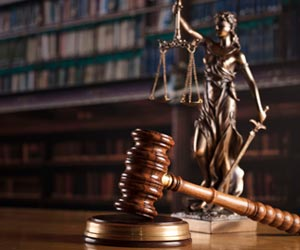 The Statue Of Justice and Gavel On a Table